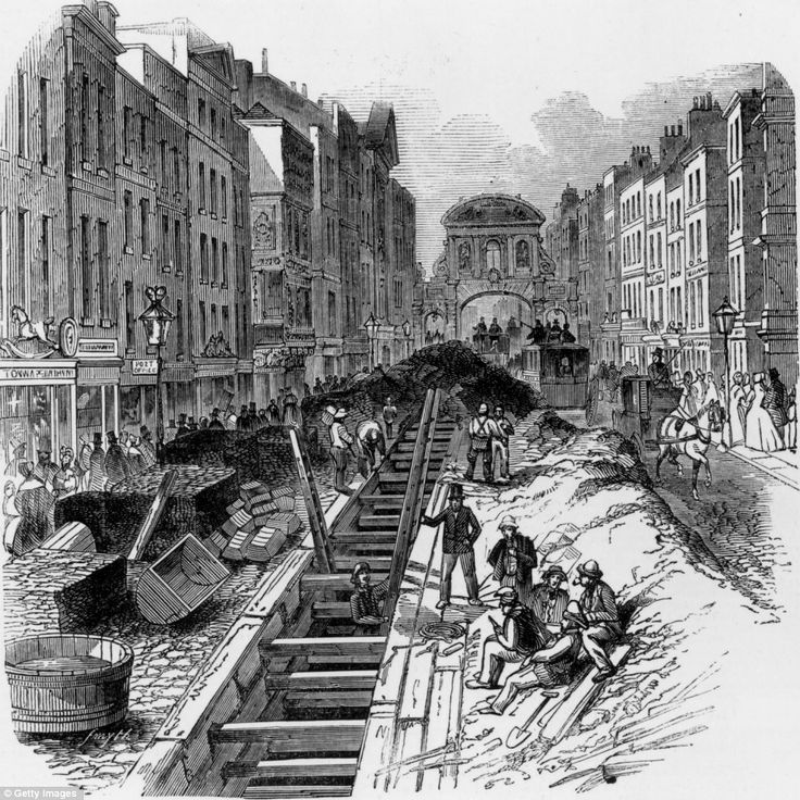Workmen deepening the sewage system that runs under London's Fleet Street in 1845