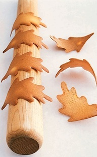 Leaf cut-out cookies on rolling pin right out of the oven, cool 3-D effect!