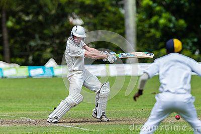 Batman strikes ball,cricket game action with batsmen and bowlers  between Westville plays Durban Boys High 1st Teams school derby.