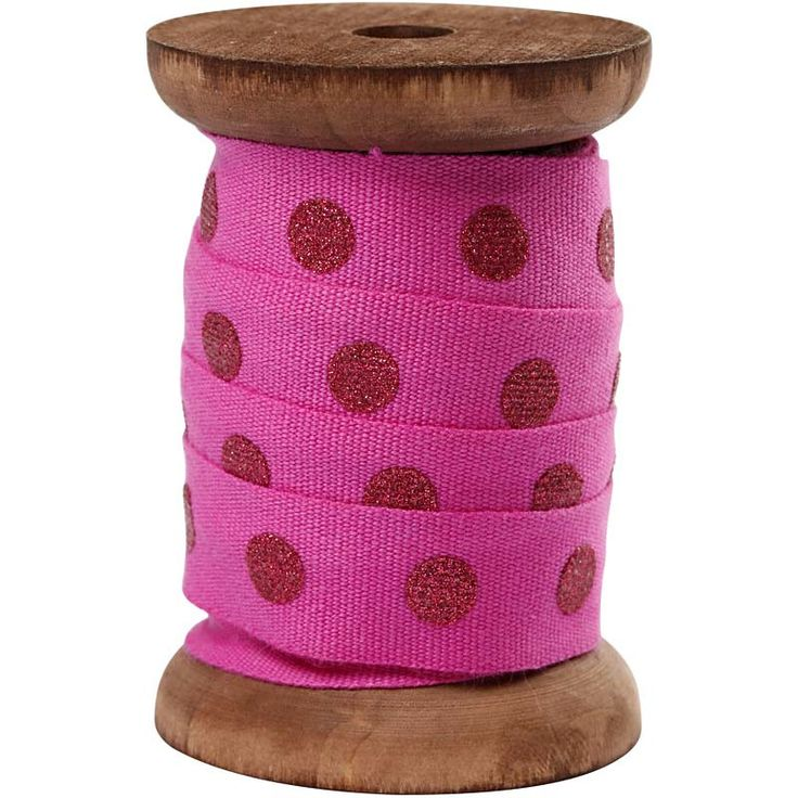 Pink polka dot ribbon on vintage style spool