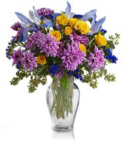 Voluptuous Blooms: iris, spray roses and chrysanthemums, in cool hues of blue and lavender mixed with brilliant yellow.