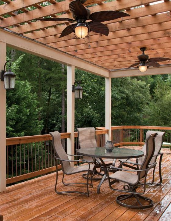 Wooded Deck Area With Pergola And Ceiling Fan