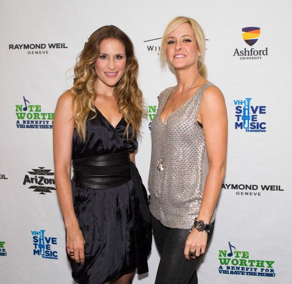 Martie Maguire and Emily Robison of Court Yard Hounds pose for a photograph at a benefit for VH1 Save The Music Foundation At William Hill Estate...