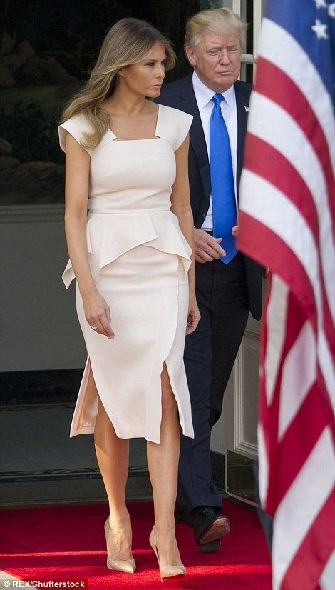 US President Donald Trump and First Lady Melania Trump walk out to receive South Korean President Moon Jae-in and his wife Kim Jeong-suk at the White House in Washington, DC, on June 29, 2017.  Melania's dress was designed by Roland Mouret. +