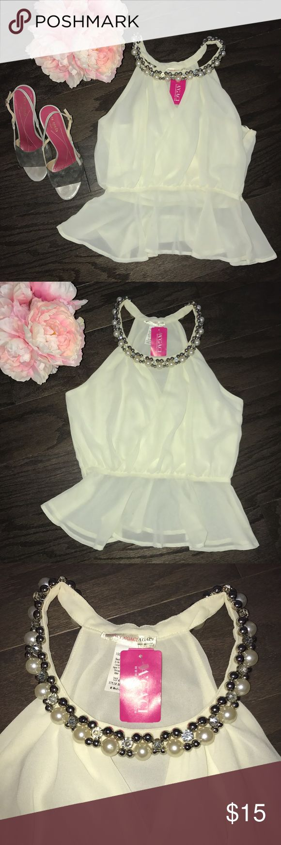 A'gaci ivory top accented with pearls and jewel New with tags, gorgeous ivory dressy top accented with pearls and jewels. Size small. I just took it out of storage and it just has minor make up stain from trying this top on (see pic) I would wash and it will come out but I don't wanna remove the tag. Easy fix though a'gaci Tops Blouses