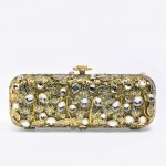 Victoria.  Glamourous clutch to lift any outfit.  Wear it with a pair of jeans and white shirt for that understated radiant look.  Mollie Day.