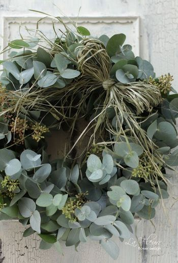 Thicker, fuller eucalyptus wreath with rustic raffia bow. Some hessian might be nice too