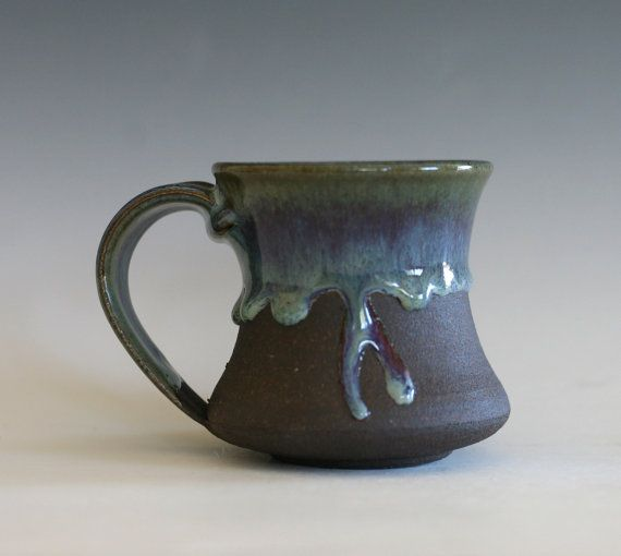 "3.5 tall, 3"" opening, holds 8 oz  The dark clay used for this small mug is fired to a deep, rich brown. Part of the exterior is left unglazed with"