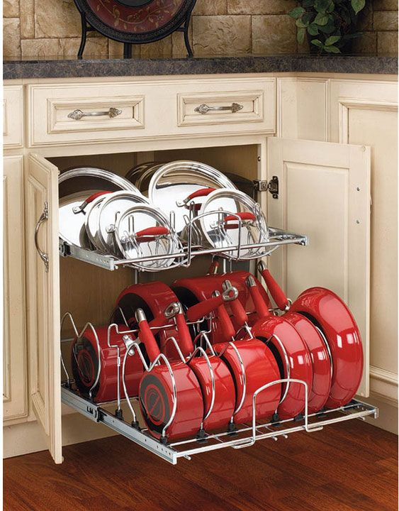 Organized Pots & Pans Storage! This is a really easy, great way to store store pots and lids. With a place for every piece it's easy to put things back where they belong!