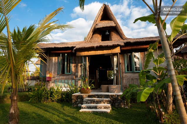 Loft-like Joglo (traditional Javanese teak house) is yours to rent in Bali, Indonesia. The interior is lovely. Lotus pond. Rice paddies. Family temple. Complete serenity.