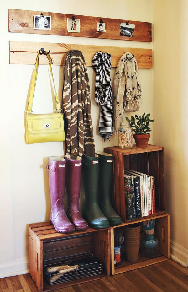 Would be great in our mud room in the new house. Entry decor-great use of crates, and I love the simplicity of the coat hangers.