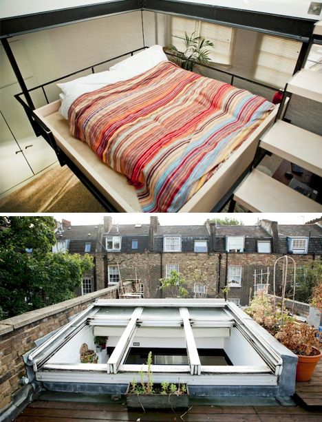 this strangely central bed in an old london townhome occupies an space in an openplan loft hovering between floor and ceiling connecting