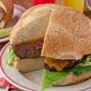 """You won't hear """"Hamburgers again?!"""" from your family when you serve up this big burger that everybody can share. Instead, you'll hear, """"Can you make that fun burger again, Mom?!"""""""