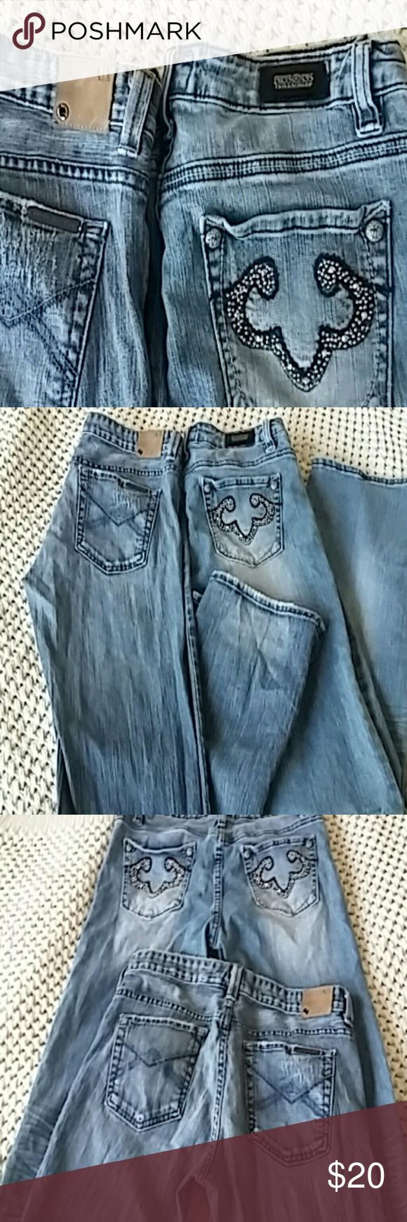 Armani Exchange and Rerocks Jeans Both in excellent condition! Armani pair has some distressing on front legs. They are a 10 long, potassium jean. The Express Rerocks were barely worn. They have a light boot cut and the Armani pair is a straight leg. Both have some stretch to them also. Armani Exchange Jeans Boot Cut