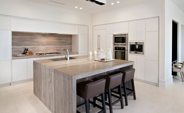 Love the sleek waterfall counter top in this Troon Scottsdale home.