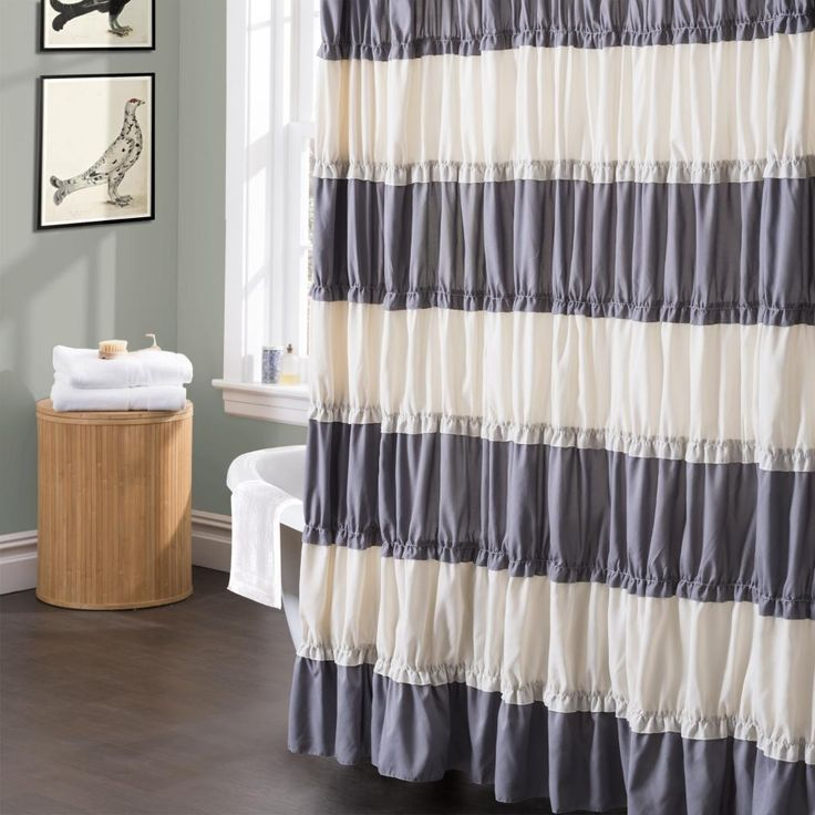 This gray and white shower curtain will surely brighten up your bathroom. The Isla shower curtain is made of heavily brushed pieced poly and lovely ruffle details.