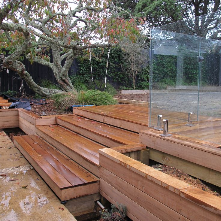 Timber retaining wall, steps and planter faced with vitex
