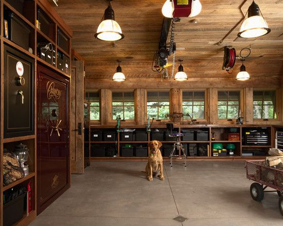 I love the heavy-duty look of this garage. All of the wood and especially the lights. Highcroft Hunting Barn by Murphy & Co. Design in Buffalo, Minnesota