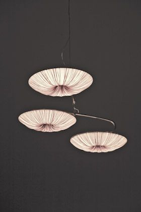 """These perfectly round shaped discs of Stand By Collection are available in a wide range of sizes. Stand By elegantly radiates brilliance across large areas and adds a unique refinement to any space.Mobiles are suspended from a brushed stainless steel ceiling plate, 28cm/ 11"""" by a 4 mm stainless steel cable, pre-cut to length, with a clear electrical cord."""