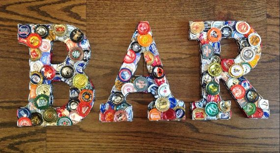 This one of a kind sign (BEER or BAR) can be the perfect wall decoration for any kitchen, bar, dining room, basement or man cave. It can also be a perfect gift for any occasion. No sign will be the same as all the letters hand crafted using beer bottle caps making each one very unique. I can also make last names or someones initials upon request. Each letter on this sign is 9 tall and the width varies depending on the letter. Each letter is covered with flattened (by hand) beer bottle caps…