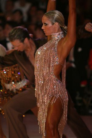Gold and sparkly - just perfect for a salsa  or bachata performance. Love this latin dance dress!