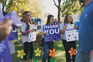 Volunteers cheer on walkers at the 2014 Denton County Walk to End Alzheimer's.