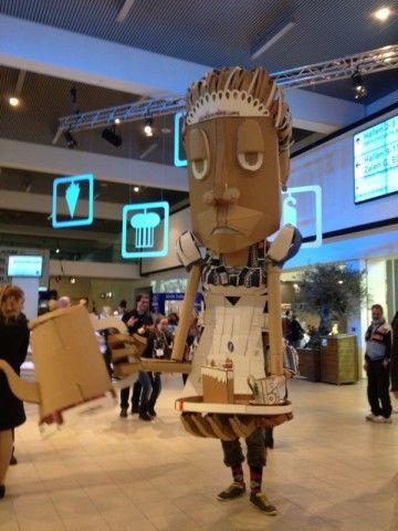 giant walking puppet made from cardboard on horecava amsterdam rai cardboarders.com