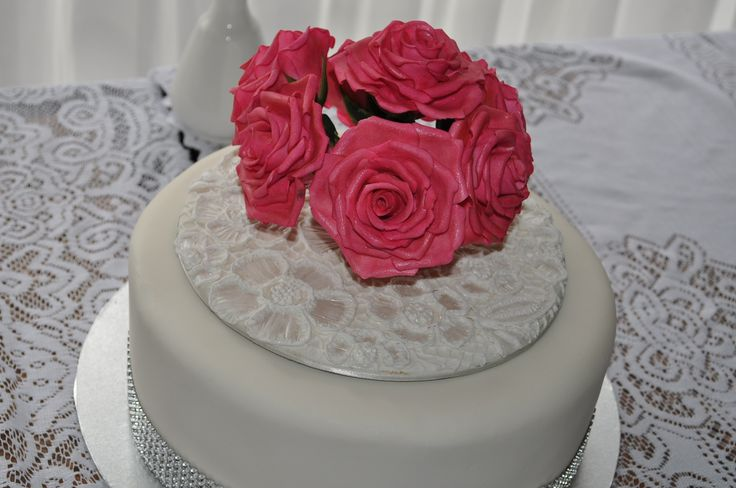 This was the middle tier of a 3 tier wedding cake.  It was the grooms mothers 100th birthday the next day so I made embroidery lace on a cake card to cover the wooden skewers and they used the rose topper of the wedding cake to finish off the cake.
