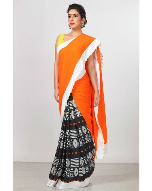 Persimmon orange sari    Featuring persimmon orange sari, it is adorned with tribal shields, spears and warrior tattoos in white and completed with an orange khadi pallu.