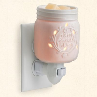 Mason Jar Pluggable Warmer ~ a decorative ceramic plug In warmer adds the perfect touch of warmth and style to your home decor. Safely warm and melt your favorite scented wax to release long-lasting fragrance. Crossroads Crumbles Scented Wax Melts are a perfect complement. A great alternative to burning candles.