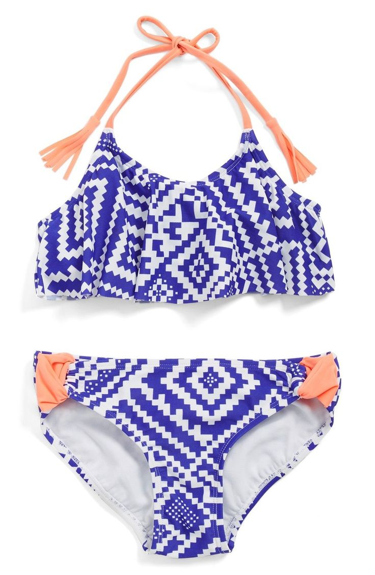 The little one will make a splash in this darling two-piece swimsuit from the #NSale. Vibrant colors, a bold geo print and tasseled ties make this cute suit a fave.