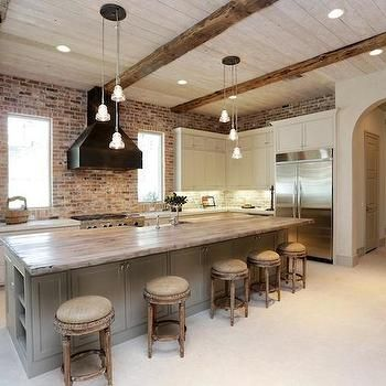 Reclaimed Wood Countertop, Brick Backsplash, Ceiling Beams, Black Vent  Hood, White Cabinets