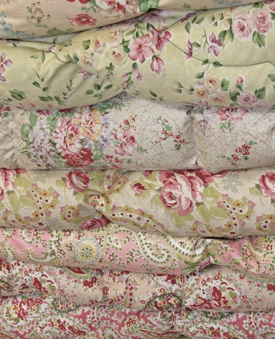 stack of lovely old eiderdownsfor pink and green bedrooms ♥