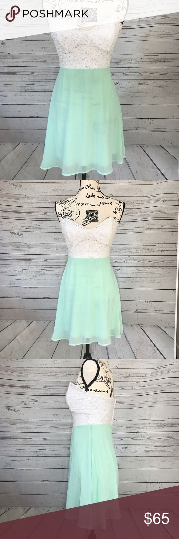 Lulus Strapless Mint Green Lace Top Party Dress Adorable Strapless party dress by lulus. A white Floral cut Lace Top is followed by a mint green skirt. Top is boned and fitted skirt is loose and flowy. Zips up the back. Worn once.  RUNS SMALL!!  Measurements coming soon! Lulu's Dresses Strapless