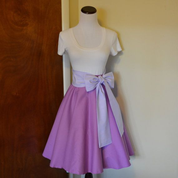 """Make every day the best day ever with our lovely Rapunzel-inspired skirt! The skirt is a lovely shade of purple called """"orchid"""", paired with a"""