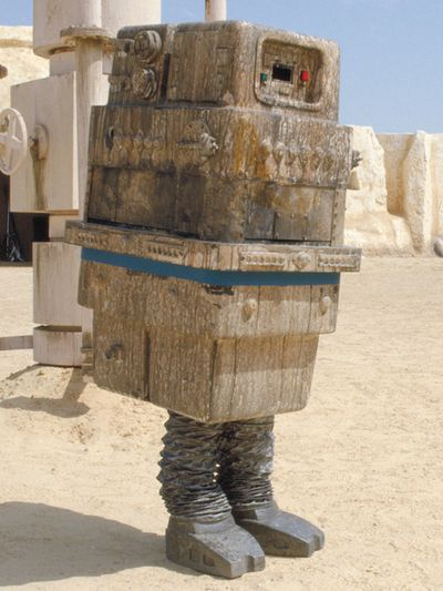 """Gonk Droid - Also known as the """"GNK power droid"""". A boxy, rectangular-shaped droid that walks very slowly. It is literally a bipedal, walking power generator. It is a playable character in the Lego Star Wars series of games and gives ammo to a player in Star Wars Battlefront II."""