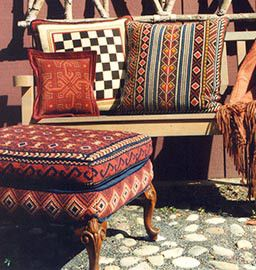 Our 2014 Annual Sale Nov. 15 to Dec. 15 includes not only pillow kits but also upholstery. One of the many patterns from the cross-pointTM collection is 'Balouch' shown on the ottoman in the photo.