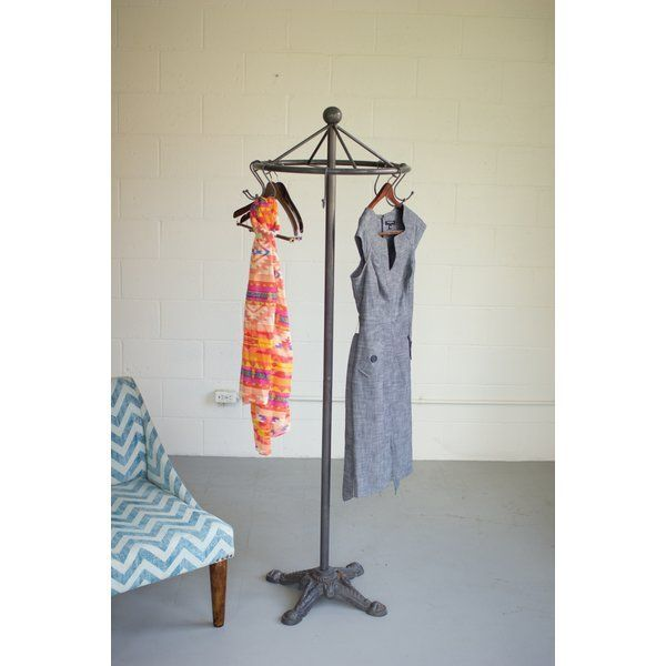 Industrial material meets antique design with this raw metal clothes rack. Ideal for displaying your favorites dresses or collection of ties, this closet in the round is convenient and stylish. #tiesrack