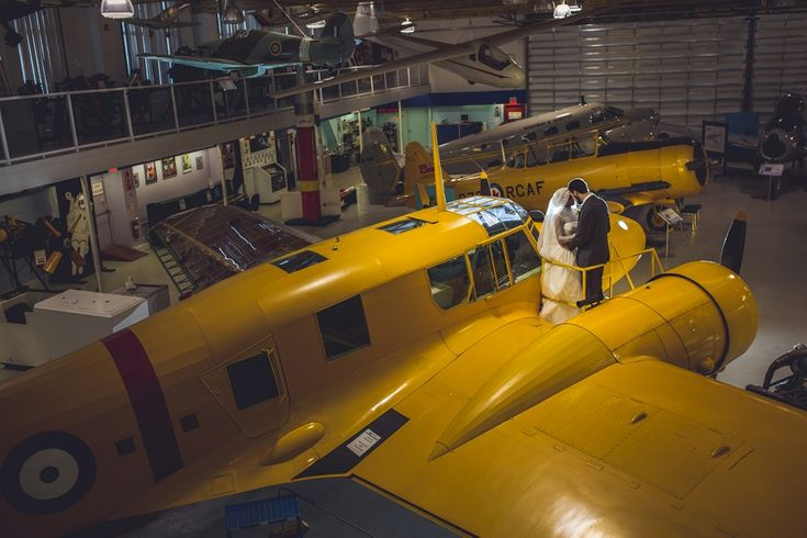 The bride and groom on top of an amazing yellow airplane from the Calgary Aerospace Museum! See more from Rimaz and Gabriel's multicultural Islamic wedding in Calgary here: http://www.annamichalska.com/2015/05/rimaz-gabriel-multicultural-islamic-wedding-in-calgary/