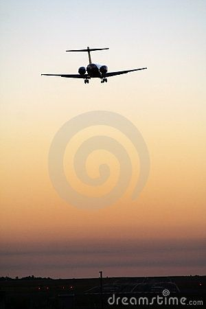 Stock Photo: Airplane landing on Darwin airport (Australia) after sunset.