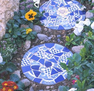 Make your own stepping stones with chipped or cracked ceramic pieces from flea-markets.