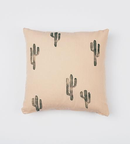 Made with a soft cotton linen blend, this pillow cover is hand stamped with an original design. The water-based ink green cactus design reminds us of cold desert nights making it perfect to snuggle up with. A zipper closure makes it easy to stuff the pillow cover with an insert.