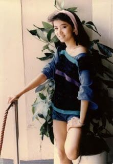 Anita Mui - This is a very nice picture of her as herself.  Good picture of the girl behind all the stage presence and costumes to be a Queen Pop Star.