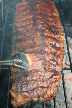 basting the Barbecue Ribs on the grill by @girlichef These ribs look incredible, can't wait to try.