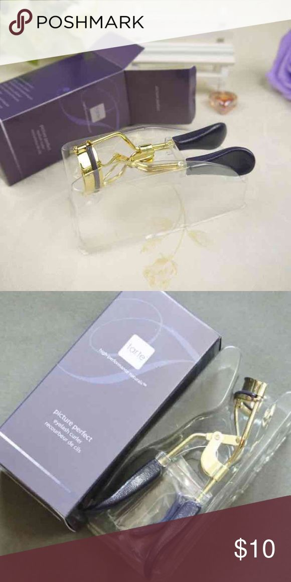 Tarte eyelash curler Brand new in box  The first ergonomically designed eyelash curler for an easy & painless eyelash curl with every use.   Easy grip handles provide a more comfortable feel while the purple silicone pad makes it easy to see every lash & allows for the appropriate amount of pressure to curl lashes naturally.   The curved angle suits all eye shapes without pinching or crimping for the perfect, pain free curl. tarte Makeup False Eyelashes