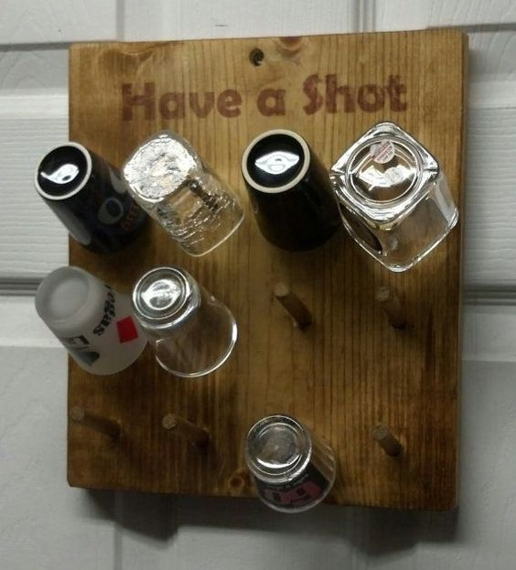 This is a pine shot glass hanging display. It holds 12 of your favorite shot glasses. It measures 10 1/2 inches high by 9 1/4 inches wide. It is made: