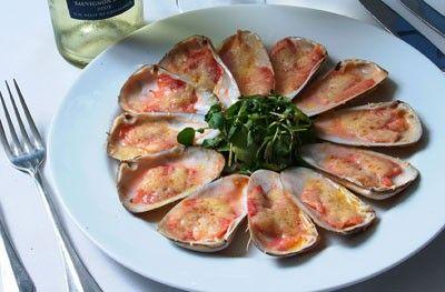 Machas a la Parmesana....(Bivalve molluscs are delicious with Parmesan cheese and lemon)