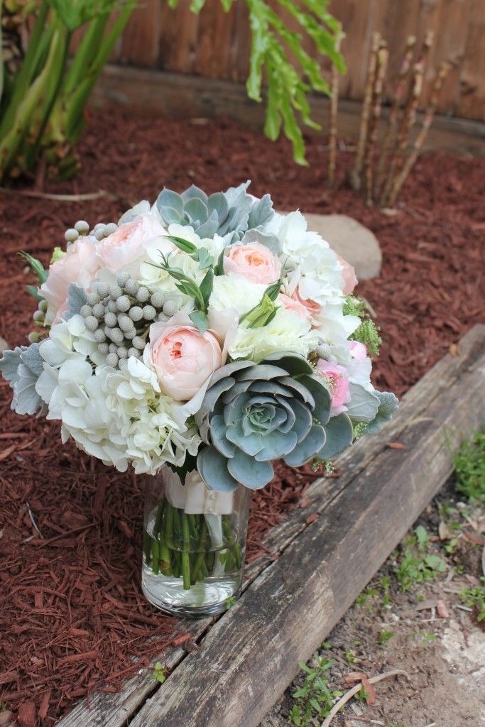 Succulent, garden roses, hydrangea bouquet. Lots of texture.  Flowers by F. Dellit Designs