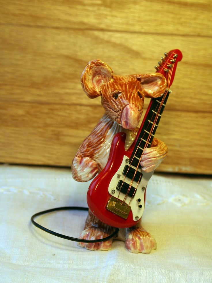 Excited to share the latest addition to my #etsy shop: A Musical Mouse called Eric. Handmade in my Sussex Pottery Studio. Eric will bring his own red guitar to his new home. All he needs is love. #housewares #homedecor #brown #birthday #christmas #musicalmouse #electricguitar #guitarmouse