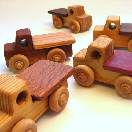 This flatbed truck can haul around all of your important freight. Differs from the semi in size and the small flatbed is one piece. Cargo can be purchased separately. See my other listings. Custom crafted from scraps from other woodworkers, broken furniture or tree limbs. Finished with